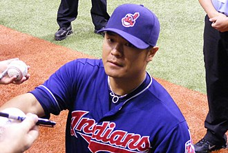 Shin-Soo Choo - Choo signs autographs for fans prior to a game against the Tampa Bay Rays.