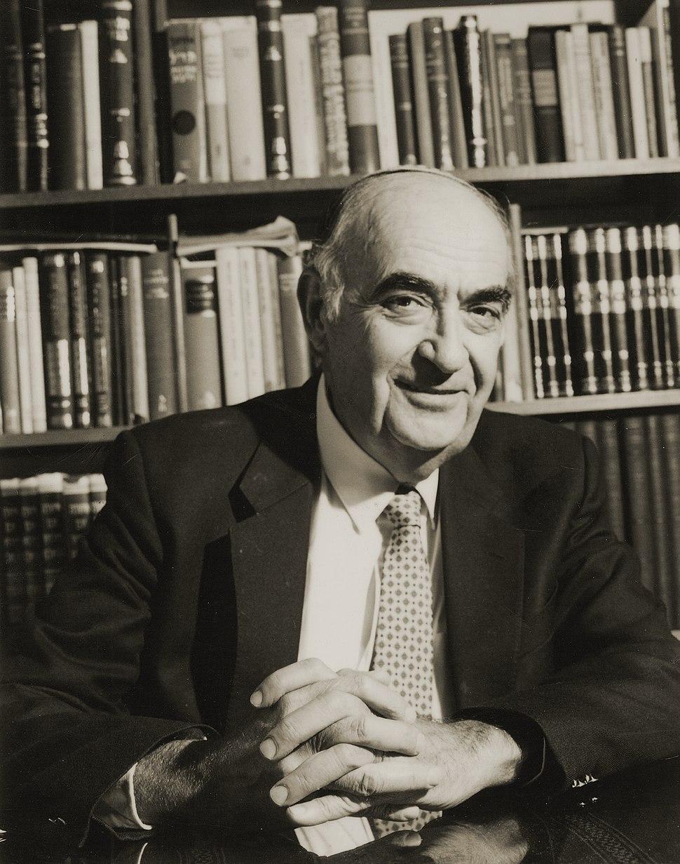 Shlomo Morag with his bookcase