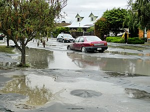 Sand boil - Sand boils and a silt-covered street after the 2011 Canterbury earthquake.