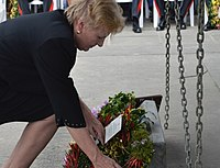 Catherine Ebert-Gray, United States Ambassador to the Solomon Islands, is pictured in a color photograph laying a wreath at the Munro memorial at the Point Cruz Yacht Club in 2017.