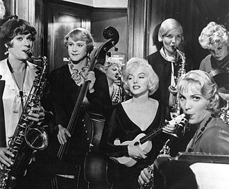 With Tony Curtis and Jack Lemmon in Billy Wilder's Some Like It Hot (1959), for which she won a Golden Globe Some like it hot film poster.jpg