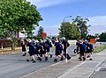 St Aidan's Anglican Girl's School students crossing the road with Lollipop Lady watching.jpg