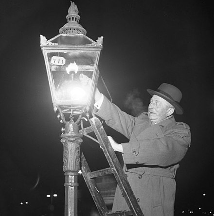 A lamplighter lighting a gas streetlight in Sweden, 1953. By this time, remaining gas lamps were rare curiosities. Stockholmgas 1953.jpg