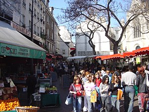 Rue Mouffetard - Street markets such as this one in Rue Mouffetard are still common in France. Resellers and farmers sell fruits and vegetables, but also meat and fish, and other products.