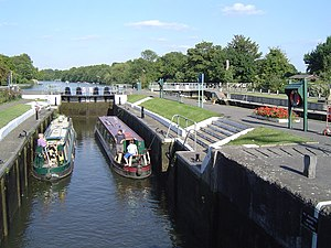 Sunbury Lock - Sunbury lock with boats in the older hand-operated lock. The new lock is on the right