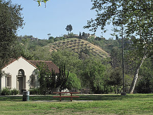 Ernest E. Debs Regional Park - View from Sycamore Grove Park to the hillside solar panels and Ernest E. Debs Regional Park in Montecito Heights.