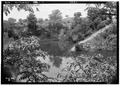 THE OLD LIME PIT LOOKING SOUTH. - Chewacla Limeworks, Limekiln Road, Chewacla, Lee County, AL HABS ALA,41-CHEWA,1-2.tif