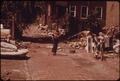 THE WAY HOME FROM SCHOOL - CRUMBLING SIDEWALKS AND PILED UP TRASH. 73RD STREET COURT IN INNER CITY - NARA - 550249.tif