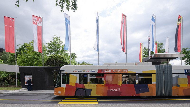 TOSA Bus at PALEXPO with flag