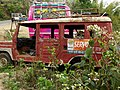Tableau of Vehicles and Wildflowers - Outside Tansen - Nepal (13797425994).jpg