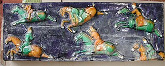 A Tang sancai-glazed carved relief showing horseback riders playing polo Tang Dynasty-Polo Game Relief Block.JPG