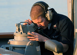 Alidade - A U.S. Navy sailor using a telescopic alidade.