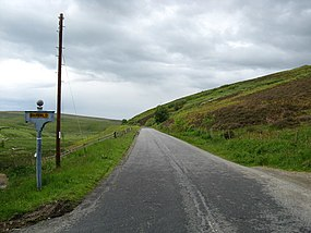 The B7007 passing the entrance to Garvald Farm - geograph.org.uk - 1358846.jpg
