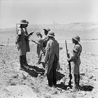 70th Infantry Division (United Kingdom) - British infantry question captured Vichy French troops, near Damascus.