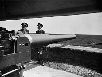 Ronald Forbes Adam - The Commander in Chief Home Forces, General Sir Alan Brooke (left), during a visit to Northern Command with Adam (right), conferring around a 6-inch coastal defence gun on August 1940