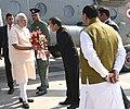 The Prime Minister, Shri Narendra Modi being welcomed, on his arrival, at Gandhinagar, in Gujarat on December 10, 2016.jpg