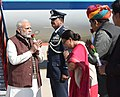 The Prime Minister, Shri Narendra Modi being welcomed by the Chief Minister of Rajasthan, Smt. Vasundhara Raje, on his arrival at Uttarlai Air Force Station, in Barmer, Rajasthan on January 16, 2018.jpg