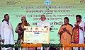 The Prime Minister, Shri Narendra Modi distributing the certificate to beneficiaries of the Pradhan Mantri Awas Yojana (Rural & Urban), at Shahanshahpur, Varanasi, Uttar Pradesh (1).jpg
