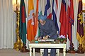 The Prime Minister Dr. Manmohan Singh signing the visitors book at a reception hosted by the Prime Minister of Thailand Mr. Thaksin Shinawatra in Bangkok on July 30, 2004.jpg