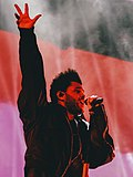 The Weeknd with hand in the air performing live in Hong Kong in November 2018 (cropped).jpg