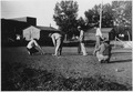 The men play a game of croquet - NARA - 285891.tif