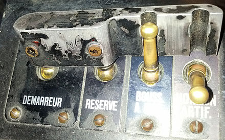 Toggle switches with the shared cover preventing certain forbidden combinations Toggle switch logic.jpg
