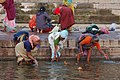 Traditional rites of India - putting a fire on the Ganges.jpg