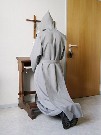 Monasticism - Trappist monk praying in his cell.