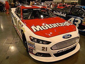 NASCAR rules and regulations - The 21 Wood Brothers Ford featuring the name of Trevor Bayne and Ford logos on the windshield header.