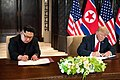 Trump and Kim signing joint statement.jpg