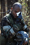 U.S. Air Force Senior Airman Kendrick Pack, assigned to the 169th Logistics Readiness Squadron, wipes tears from his eyes after exiting the mask confidence chamber during chemical warfare training at McEntire 080209-F-WT236-015.jpg