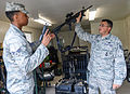 U.S. Air Force Tech. Sgt. Cesar Riquelme, right, with the 116th Security Forces Squadron (SFS), Georgia Air National Guard, issues an M4 carbine and an M9 pistol to Senior Airman Demetruis Yancey in the armory 140629-Z-XI378-003.jpg