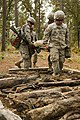 U.S. Army Pfc. Peter Liets, an Expert Field Medical Badge (EFMB) candidate with the 108th Air Defense Artillery, guides a litter team carrying a simulated patient through rough terrain during the EFMB 131104-A-KS175-005.jpg