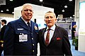 U.S. Coast Guard Vice Adm. John P. Currier, left, vice commandant of the Coast Guard, poses for a photograph with a guest during the 2013 Navy League Sea-Air-Space Exposition in National Harbor, Md., April 8 130408-G-ZX620-016.jpg
