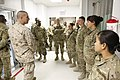 U.S. Marine Corps Sgt. Maj. Bryan B. Battaglia, second from left, the senior enlisted adviser to the Chairman of the Joint Chiefs of Staff, speaks with members of the operating room team at the Heathe N. Craig 130504-A-CL397-271.jpg