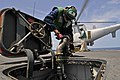 U.S. Navy Aviation Electronics Technician Airman John Hookey refuels an MQ-8B Fire Scout unmanned aerial vehicle during flight operations aboard guided missile frigate USS Simpson (FFG 56) March 6, 2012, in 120306-N-IZ292-271.jpg