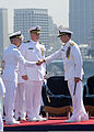 U.S. Navy Capt. Thom Burke, left, shakes hands with Rear Adm. Patrick Hall, the commander of Carrier Strike Group 9, following a change of command ceremony aboard the aircraft carrier USS Ronald Reagan (CVN 76) 130813-N-SS432-186.jpg