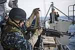 U.S. Navy Electronics Technician 3rd Class Dillon Fair, assigned to the amphibious transport dock ship USS Denver (LPD 9), loads ammunition into an M240B machine gun before a live-fire exercise March 10, 2014 140310-N-ZU025-009.jpg
