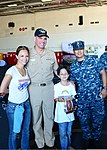 U.S. Navy Vice Adm. David H. Buss, center left, the commander of Naval Air Forces, poses for a photo with a family in the hangar bay aboard the aircraft carrier USS Ronald Reagan (CVN 76) during 130828-N-SS432-123.jpg