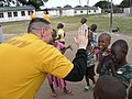 U.S. Navy Yeoman 1st Class Dave Honegger, left, interacts with Tanzanian children during a community relations event at Kinondi Muslim High School in Dar es Salaam, Tanzania, June 29, 2012, during Africa 120629-N-GA722-024.jpg