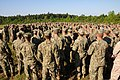 U.S. Sailors assigned to Naval Mobile Construction Battalion 11 gather for instruction to begin during a day of unit-level training while participating in a field exercise (FEX) at Camp Shelby, Miss., May 14 130514-N-UH337-005.jpg