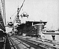 USS Mindoro (CVE-120) loading Curtiss SB2C Helldivers for Italy at Naval Station Norfolk, in September 1950.jpg