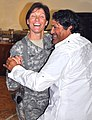 US Army 53063 Lt. Col. Paula Lodi, commander 15th Special Troops Battalion, 15th Sustainment Brigade, dances with Alex Cruz, logistics warehouse contractor and Salsa dance instructor, at a Hispanic Heritage month l.jpg