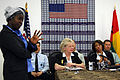 US Embassy employee Dina Adao translates into Portuguese during a news conference.jpg