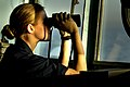 US Navy 030316-N-3783H-709 U.S. Navy Ensign Katharine Poole watches through binoculars for any surface contacts from the bridge aboard the guided missile cruiser USS Shiloh (CG 67).jpg