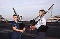 US Navy 030503-N-4953E-002 Electronics Warfare Technician Seaman William Lapinel and Air Traffic Controller 3rd Class Scott Watson play Bagpipes on the flight deck aboard USS Harry S. Truman (CVN 75) as the aircraft carrier lea.jpg