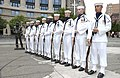 US Navy 030708-N-5862D-127 Members of the U.S. Navy Ceremonial Guard stand in formation next to the Lone Sailor statue at the U.S. Navy Memorial.jpg