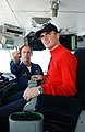 US Navy 030728-N-4616B-015 Capt. Bill Goodwin, Commanding Officer of USS Ronald Reagan (CVN 76), along with Sailor of the Day recipient Aviation Ordnanceman Airman Kenneth Rice, enjoy the view from the Captain's chair on the Na.jpg