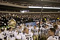 US Navy 031206-N-6157F-003 The Navy Midshipmen celebrate at the conclusion of the 104th playing of the Army Navy game.jpg