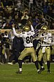 US Navy 031206-N-9693M-506 Navy kicker Eric Rolfs (80) celebrates a field goal with quarterback-holder Craig Candeto during the 104th Army Navy Game.jpg